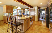Large wood kitchen with hardwod floor and wood beam. — Stockfoto