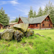 Постер, плакат: Classic old log cabin house in the country side