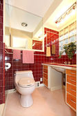 Burgundy antique bathroom interior. — Stock Photo