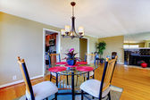 Dining room with round table and fireplace. — Stock Photo