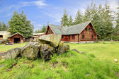 Classic old log cabin house in the country side. — Stock Photo