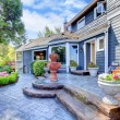 Blue house entrance with fountain and nice patio. — Stock Photo