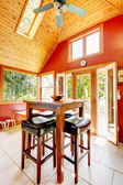 Luxury vaulted wood ceiling dining room with red walls. — Stock Photo