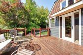 House exterior with large open deck with outdoor furniture. — Stock Photo