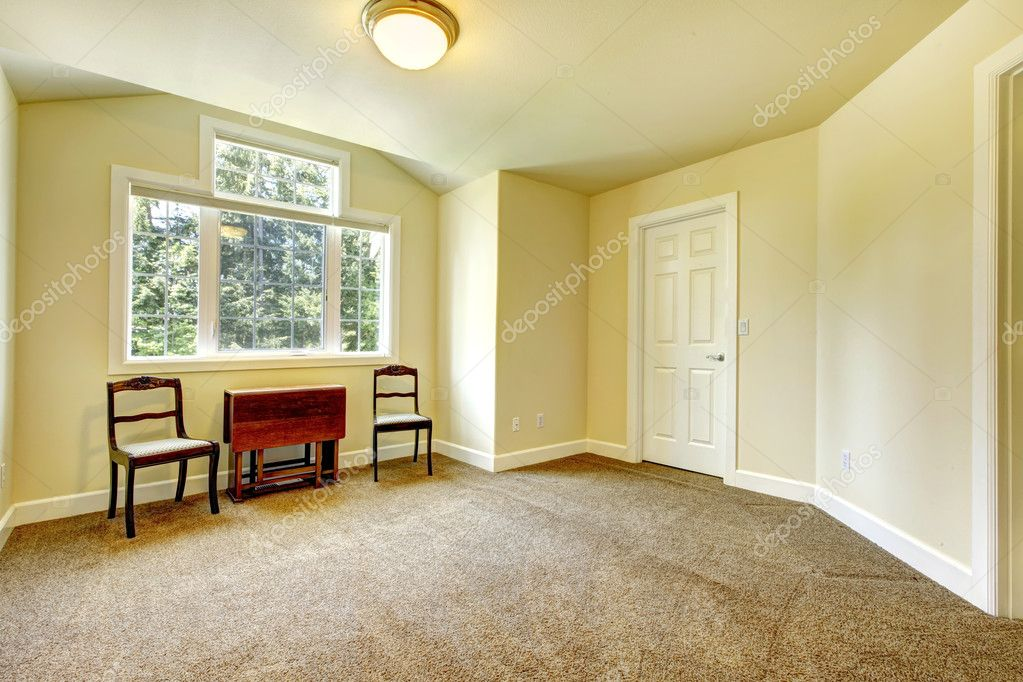 Empty room with yellow walls and brown carpet stock for Brown and yellow walls