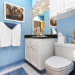Blue wnad white small bathroom sink and toilet. — Lizenzfreies Foto