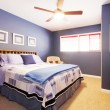Stock Photo: Blue bedroom interioe with navy bedding.