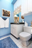 Blue wnad white small bathroom sink and toilet. — Stock Photo