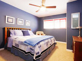 Blue bedroom interioe with navy bedding. — Stock Photo