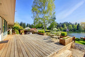 Large wood deck with lake and spring landscape. — Stock Photo