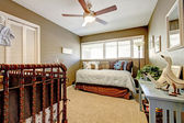 Kids nursery interior with blue and brown bed. — Foto de Stock