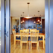 Stock Photo: Dining room table through open balcony doors.
