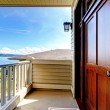 Front luxury wood door with water view. — Stock Photo #12074751