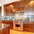 Luxury pine wood beautiful custom kitchen interior design. - Stock Photo