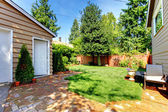 Backyard with house and garage and two doors. — Stock Photo