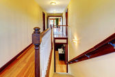 Stairway with hardwood floor and wood railing. — Foto Stock
