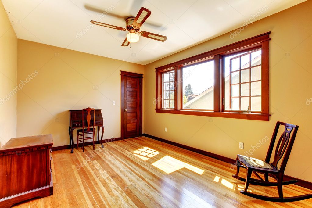 depositphotos_12075425 stock photo empty room with yellow walls