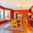 Red dining room with hardwood floor and many windows. — Stock Photo