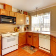 Wood and beige walls American standart kitchen. - Stock Photo
