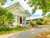Small cute craftsman American house wth green and white. — Stock Photo