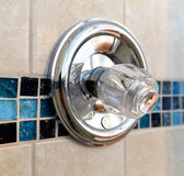New shower handle with tile wall in beige and blue. — Stock Photo