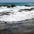 Ocean Wave over Rocks — Stock Photo #10740825