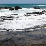 Ocean Wave over Rocks — Stock Photo