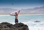 Man on Beach Rocks — Stock Photo