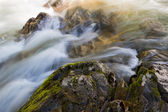 Rocks in Fast Moving Water — Stock Photo