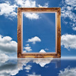 Stock Photo: Photo frame on the blue sky field.