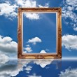 Photo frame on the blue sky field. — Stock Photo