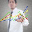 Business man pushing finance graph for trade stock market on the whiteboard — Stock Photo