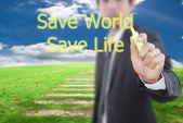 Affärsman skriva rädda världen på en blå himmel — Stockfoto