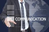 Podnikatel tlačí slovo komunikace na rozhraní dotykové obrazovky. — Stock fotografie