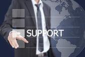 Empresario empujando palabra de apoyo en una interfaz de pantalla táctil. — Foto de Stock