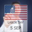 Asibusinessmpushing Labor day. — Stock Photo #11550513