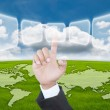 Hand pushing digital button on the blue sky field — Stock Photo