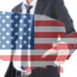 Asian businessman pushing USA flag map. — Stock Photo