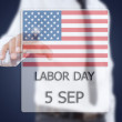 Asian businessman pushing Labor day. — Stock Photo