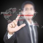 Asian businessman pushing social network — Stock Photo