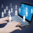 Laptop with social network — Stock Photo #11558760
