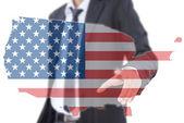 Asijské podnikatel tlačí usa vlajka mapa — Stock fotografie