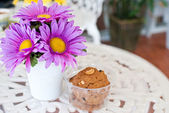Beauty flower with cookies — Stock Photo