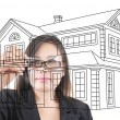 Asian business lady writing home plan — Stock Photo