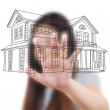 Royalty-Free Stock Photo: Asian business lady pushing house plan on the white board