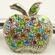Stock Photo: Colourful rhinestone apple pin