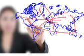 Business woman pushing social network world map — Stock Photo