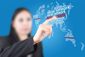 Business lady pushing Social Network world map — Stock Photo