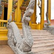 Foto Stock: Thailand Buddhstatue on temple wall