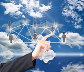 Hand pushing social network communication on the blue sky field — Stock Photo